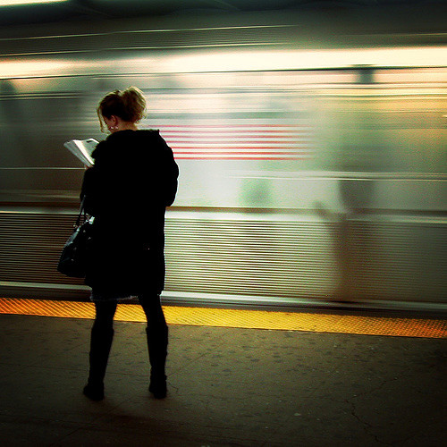 On the platform, reading - 96724309_985b8acd3f_z